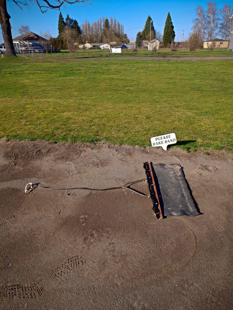Please rake sand!