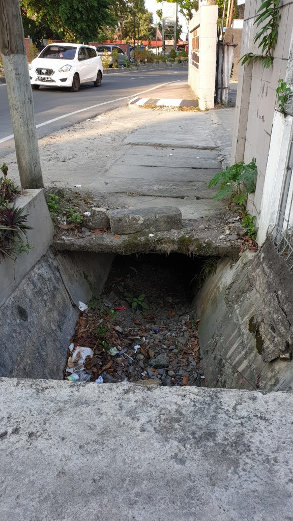 This is a normal sidewalk here in Medan Lazy days in Medan-Welcome to Sumatra