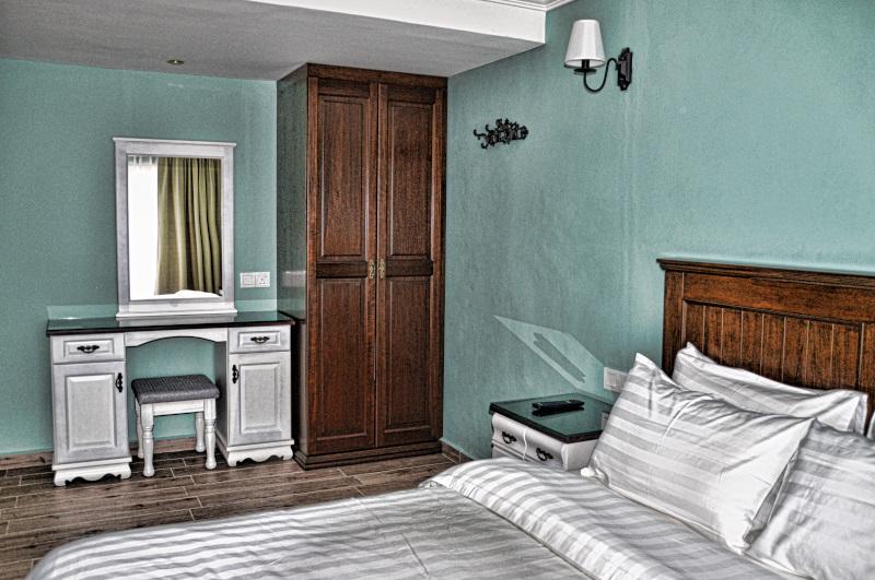 Master bedroom in 2-bedroom family suite