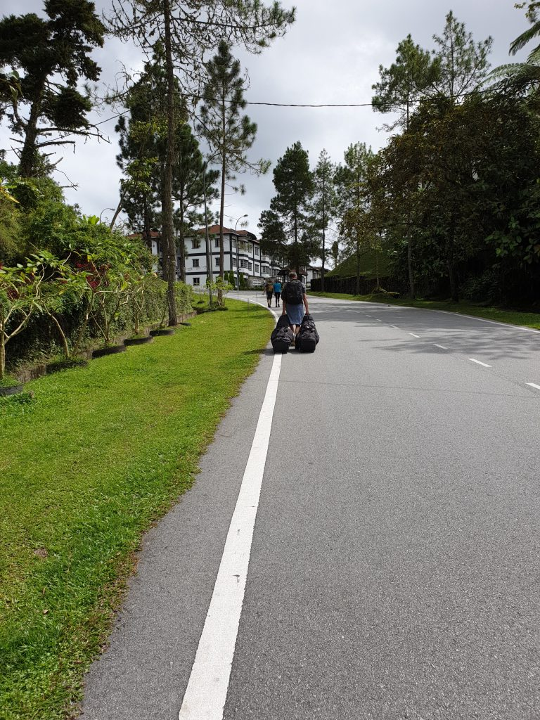 Dragging golf bags in Cameron Highlands