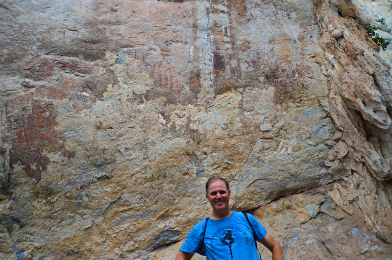 Happy husband at the rock paintings