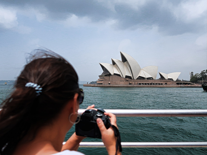 Taking pictures from the Sydney Opera House from the ferry