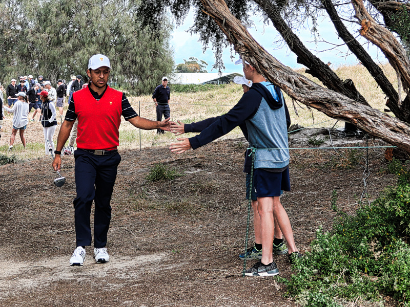 Xander Schauffele giving five at the Presdients Cup