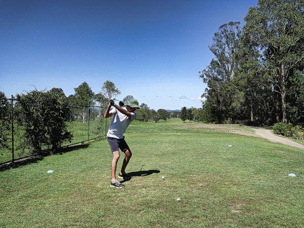 Harrison swinging aggresively on four at Gympie Golf Course