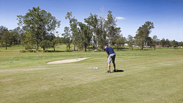 Trying to save par on the second at Gympie Golf Course