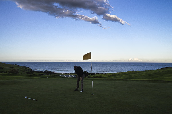 Putting agressively on eighteen at Gerringong Golf Club