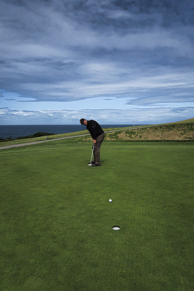 Putting for par on sixteen at The New South Wales Golf Club