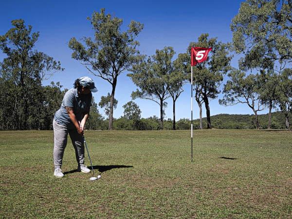 Lining up a birdie putt on five at Brandybottle Golf Club