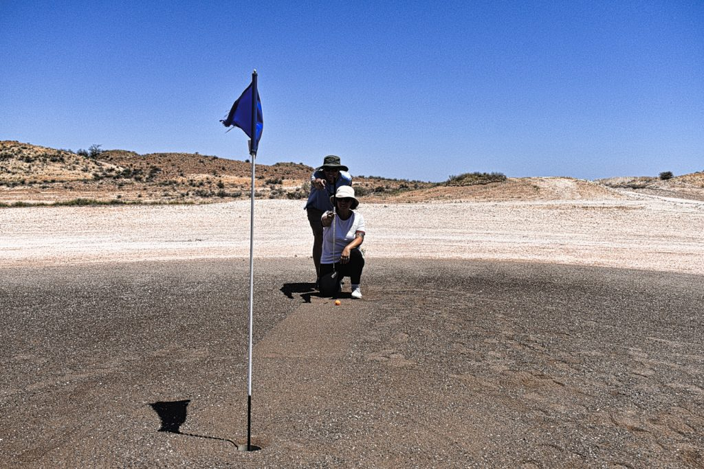 Reading the greens at Coober Pedy Opal Fields Golf Club