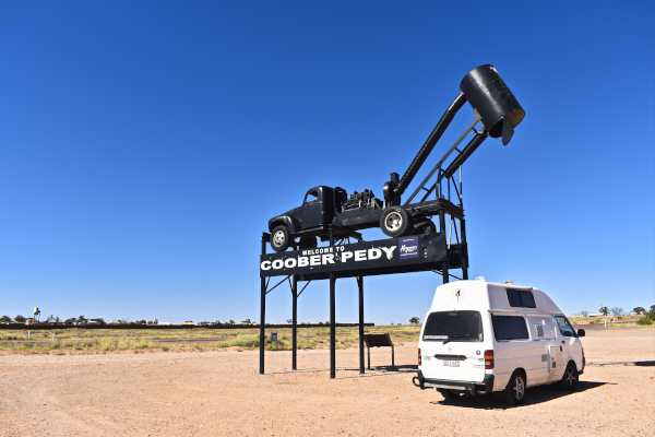 Putu at the Welcome to Coober Pedy Sign