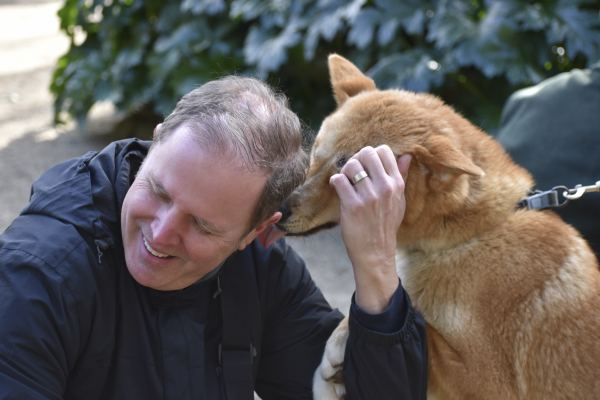 James getting kisses by a Dingo