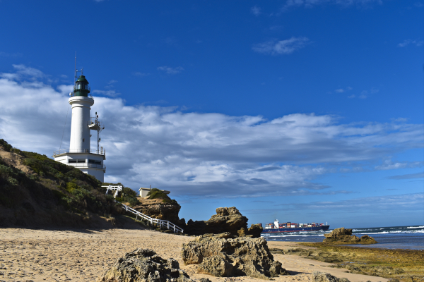 Point Lonsdale Lighthouse with a Freighter leaving Port Phillip Bay