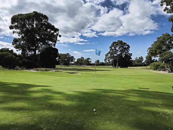 A downhill putt on three at Kingston Heath Golf Club
