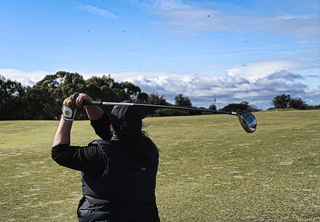The final swing on the great finishing hole at Royal Melbourne Golf Club